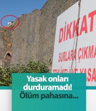 Yasağa rağmen Diyarbakır'ın tarihi surlarına çıkan vatandaşlar ölümüne fotoğraf çekiyor