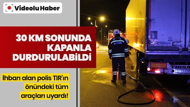 Polis ihbarı alınca TIR'ın önündeki tüm araçları uyardı! 30 km sürdü