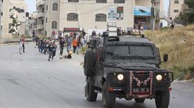 Katil İsrail askerleri 12 yaşındaki Filistinli çocuğu gözaltına aldı