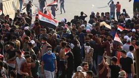Iraklı göstericiler ülkenin en önemli limanına giden yolları kapattı