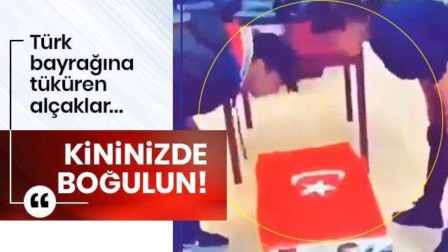 Türk bayrağına tüküren alçaklar! Kininizde boğulun