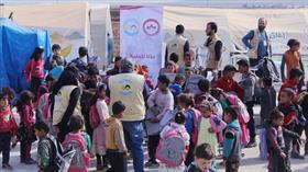 Suriyeli çocuklara kırtasiye yardımı yapıldı
