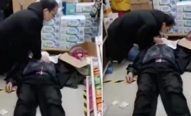 Çinli doktor, koronavirüsü göze aldı, markette yere yığılan hastaya suni solunum yaptı