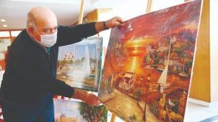 Yapboz tablolarla 79'unda sergi açtı